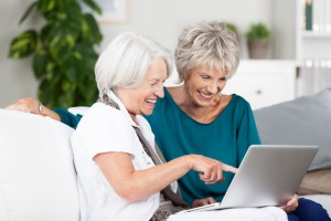 Two senior women surfing the internet